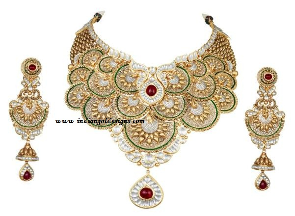 Gold and Diamond jewellery designs: tbz designer beautiful ...