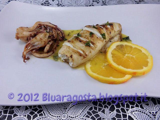 cannolo di calamaro ripieno di ricotta e arancia con salsa all'arancia