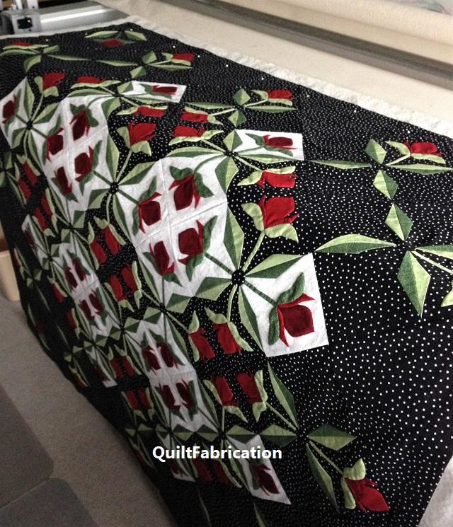Mediterranean Rose quilt by QuiltFabrication