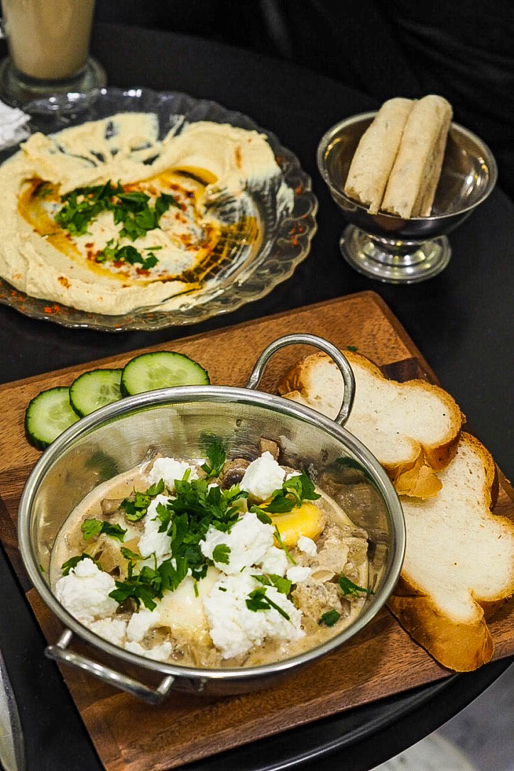 White shakshuka, hummus and pita bread
