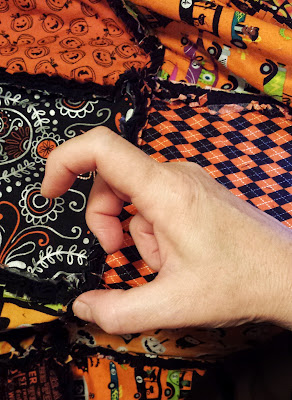 cutting rag quilts, in-progress, halloween orange and black handmade autumn rag quilt by refabulous