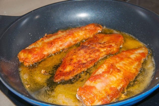 Fish fillet marinated in sweet peppers recipe food for How to cook fish fillet