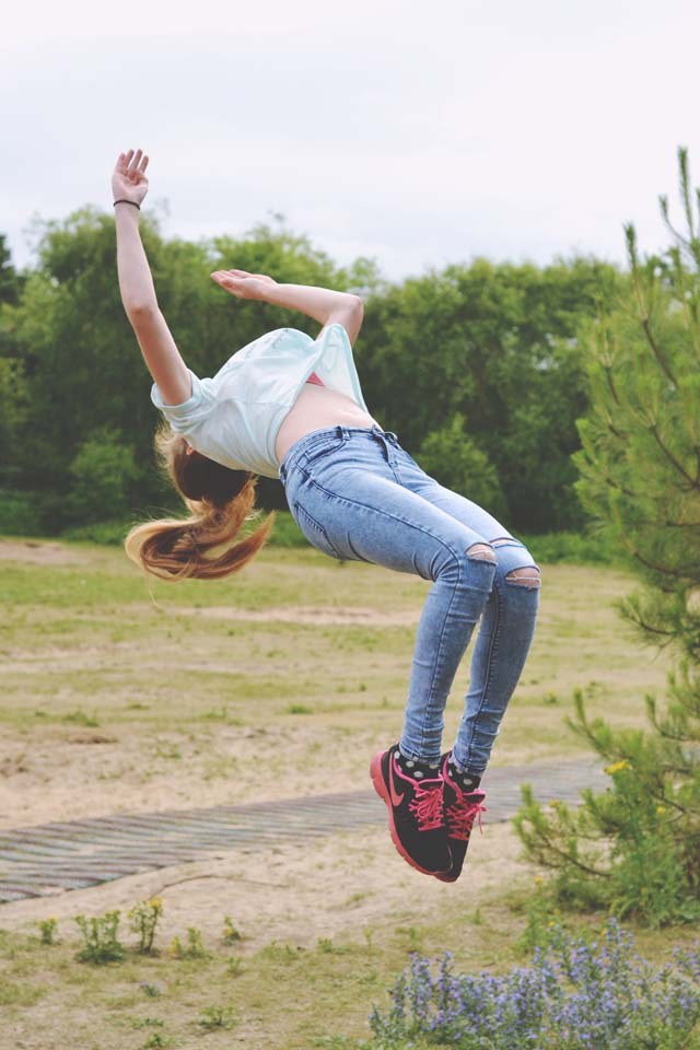 Girl doing backflip