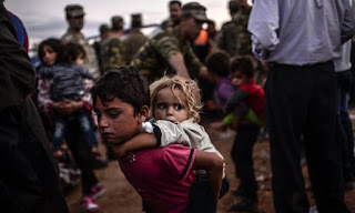 bulent kilic, refugee children, refugee crisis, refugee humanitarian help, how to help refugees