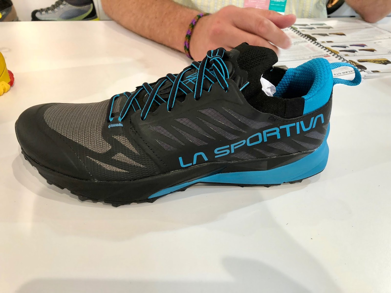59cdc2d5452 The Kaptiva is a new light weight trail runner racer with 4-5mm all terrain  lugs and a full length EVA rock guard. It is built on a new last.