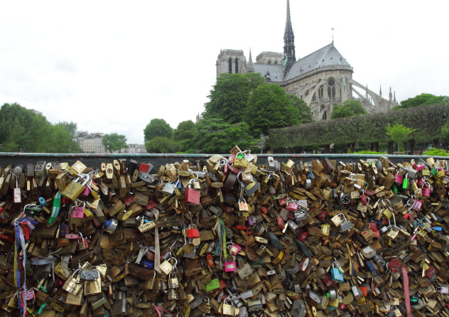 The locks of lovers and Notre Dame Cathedral, Paris