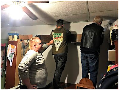April 11, 2019 Watching the hanging of shelves in my craft-room.