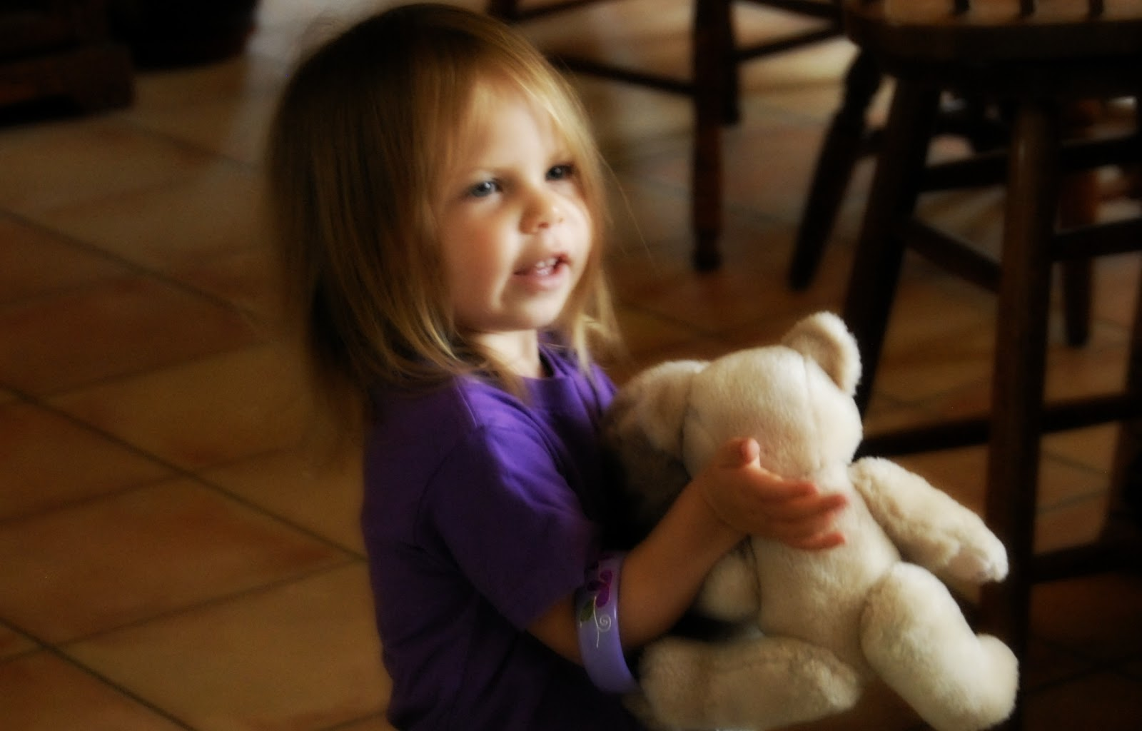 child holding a teddy bear: LadyD Books
