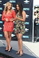 Priyanka Chopra looks super cute in happy mood wearing a short flower print dress in Hollywood 008.jpg