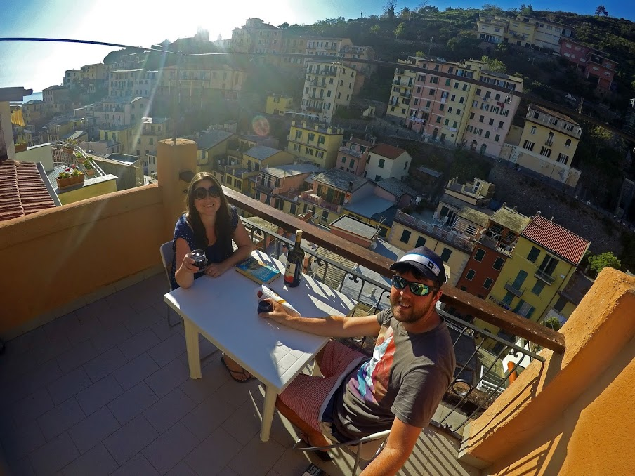 Couple on balcony in Riomaggiore Cinque Terre Italy