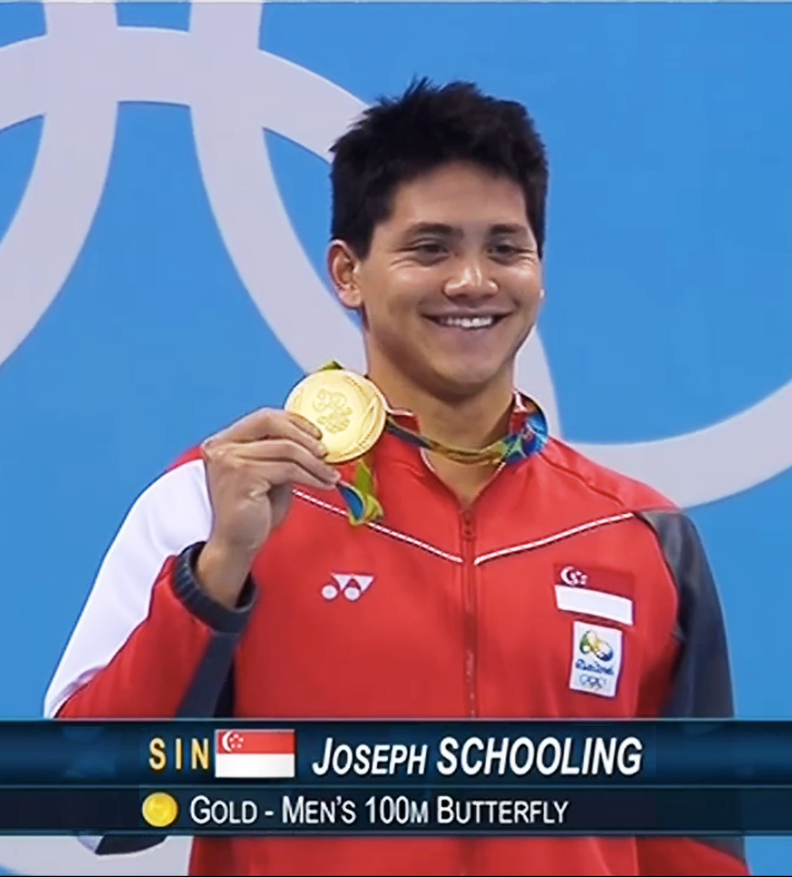NATIONAL HERO: Schooling with his gold medal from the 100m butterfly.