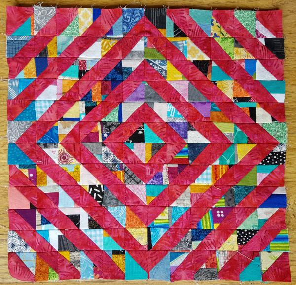 Scrappy HST quilt block | DevotedQuilter.blogspot.com