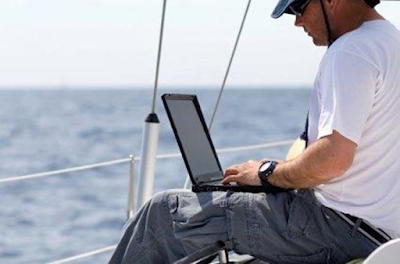 trader on laptop in a relaxing environment  - technitrader