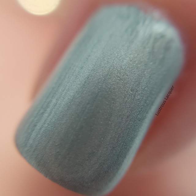 Icy sage green nail polish with a pearl finish from the Pastel City Collection