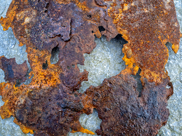 Photo of a lump of rusty metal I found on the beach and laid on a large rock