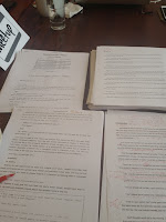 Editing a paper copy of a manuscript at a Shut Up & Write meeting at Borderland's Cafe in the Mission..