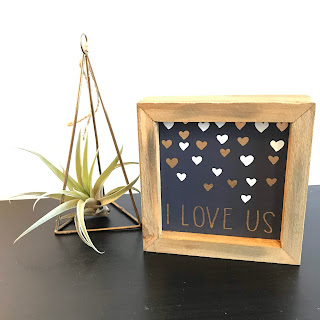 Black and gold I love us sign