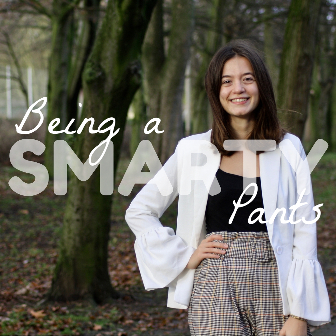 abbey, a brunette blogger, wears a white blazer and paperbag waist trousers