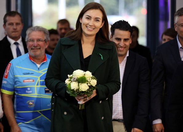 Princess Claire of Luxembourg attended the 11th Indoor Cycling Marathon. Princess Claire wore a green wool coat by Alexander McQueen