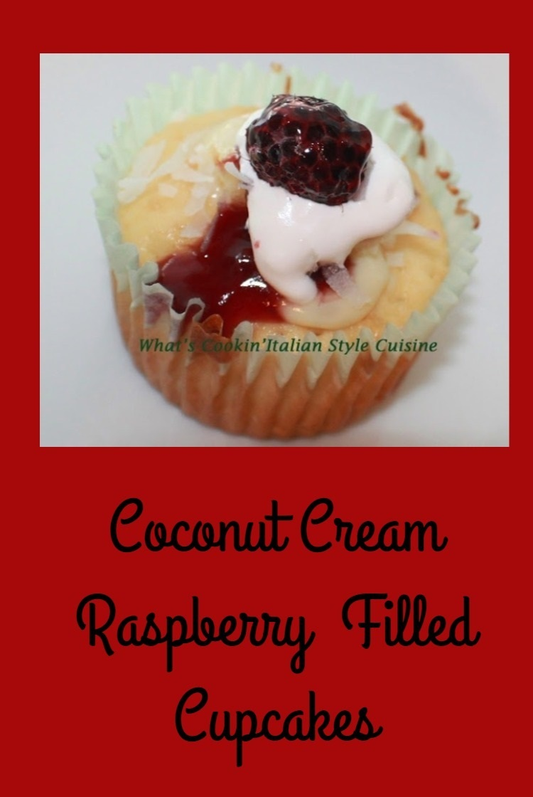 delicious golden cupcakes filled with coconut cream and raspberry