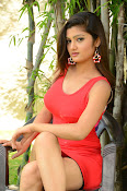 Poojitha sizzling in red dress-thumbnail-8