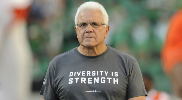 "Wally Buono sports a ""Diversity is Strength"" T-shirt"