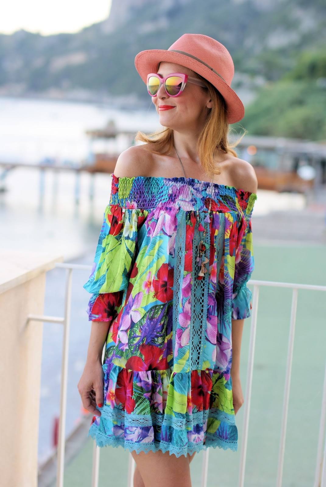 How to dress for the beach with an off the shoulder Tezuk dress on Fashion and Cookies fashion blog, fashion blogger style