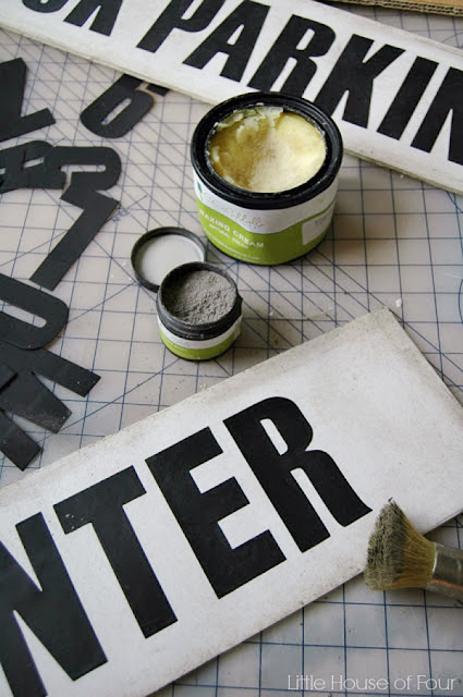A DIY tutorial for creating vintage looking signs using foam board, wax and aging dust.