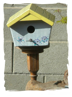 Hand painted birdhouse with antique base stand.