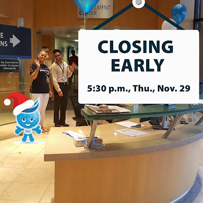 Two staff members with Rio mascot Splash wearing a Santa hat waving at camera.  Hanging sign reads: Closing Early, 5:30 p.m., Thu., Nov. 29