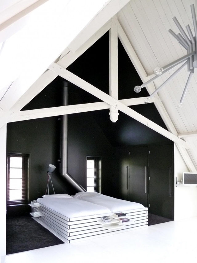 Picture of black colored walls around the bed