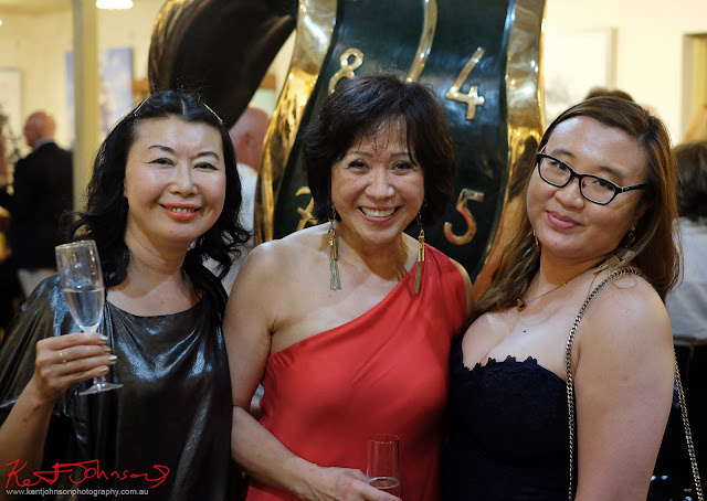 Three ladies at the party - Dali Sculptures LAUNCH at Billich Gallery - Photography by Kent Johnson for Street Fashion Sydney