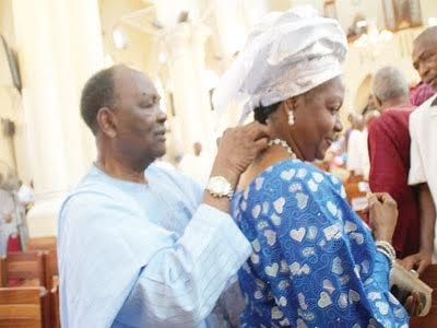 Photo Of 81-Year-Old Yakubu Gowon Helping His Wife With Her Necklace In Public Emerges