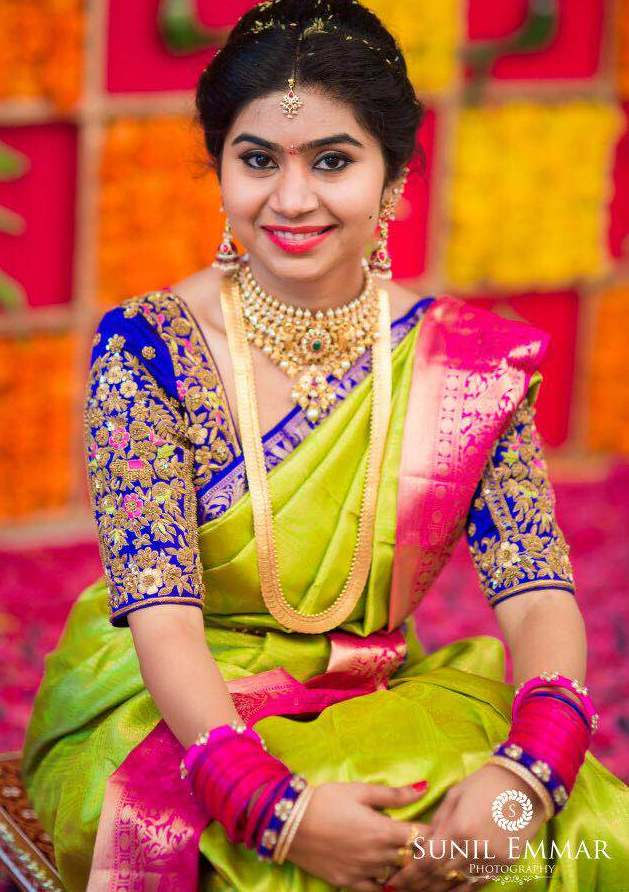 Bride in Purple Blouse Neon Green Sari