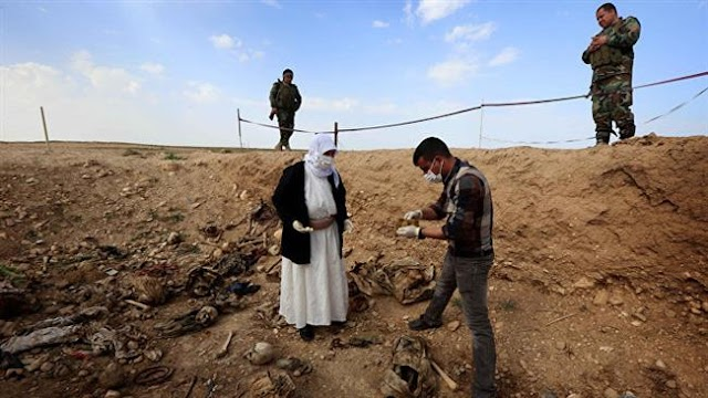 Iraqi Kurds find two new mass graves containing 18 bodies near Mosul