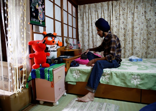 Image Attribute: Gursewak Singh sits on a bed in a room of his house during an interview with Reuters, in Matsudo, Japan, September 25, 2016. REUTERS/Kim Kyung-Hoon