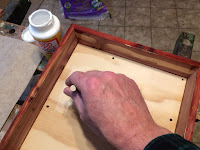 Applying a thin coat of glue