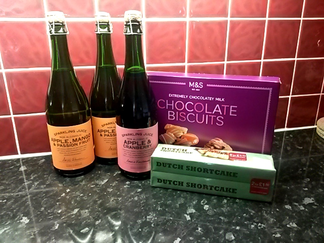 Marks and Spencers bottled sparkling juices and biscuits