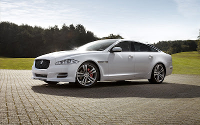 Jaguar XJ premium luxury sedan sun shine white color image
