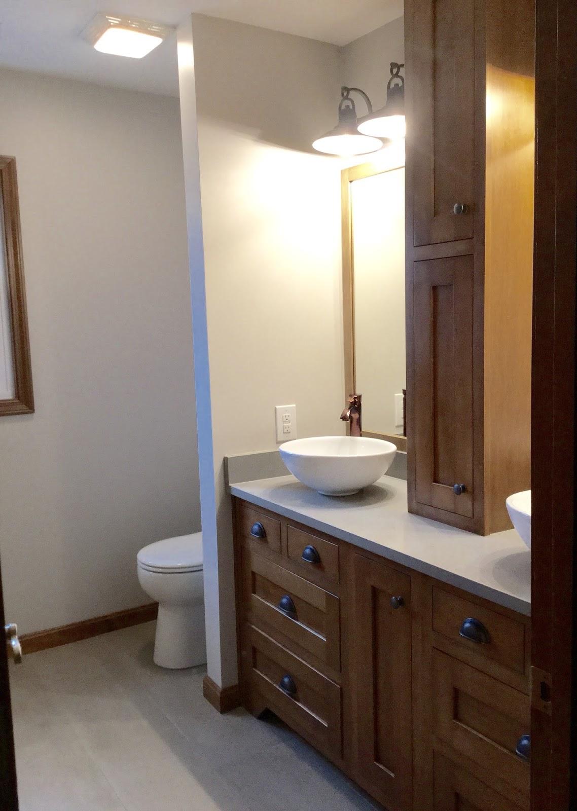 RUSTIC CABIN BATHROOM RENOVATIONS ELZ DESIGN - Bathroom colors with bronze fixtures