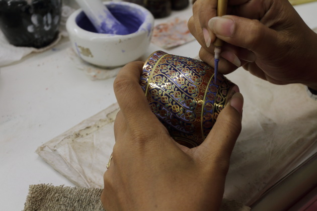 Beautiful Benjarong crockery being designed near Ban Amphawa, Thailand