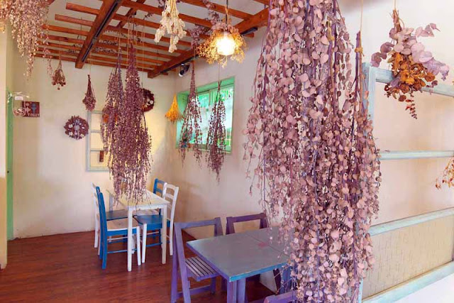 tables, chairs,cozy atmosphere, herbs