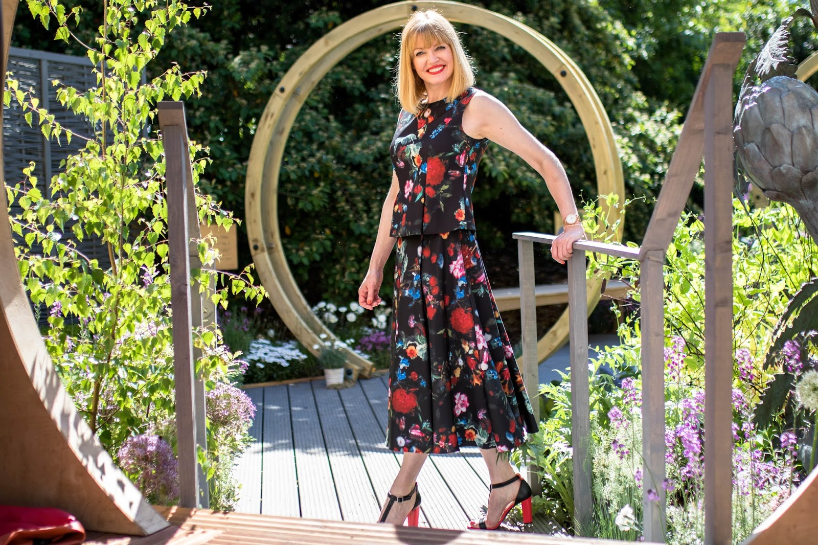 What-Lizzy-Loves-Madeleine-black-floral-peplum-top-matching-floral-midi-skirt-tomato-red-leather high-heeled-sandals-what-to-wear-Chelsea-Flower-Show