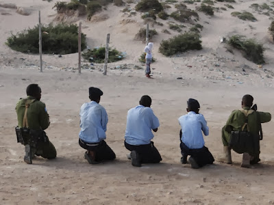 Firing squad execution in Mogadishu, Somalia, in January 2014.