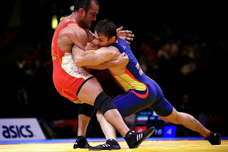 Risultati immagini per tecnica lotta olimpica
