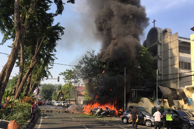 Family of IS-inspired suicide bombers including 2 children attack three churches in Indonesia; 13 dead, 40 injured