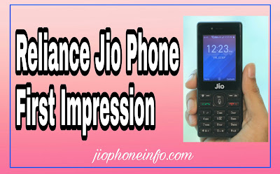 Jio Phone in right hand with text on left side first impression