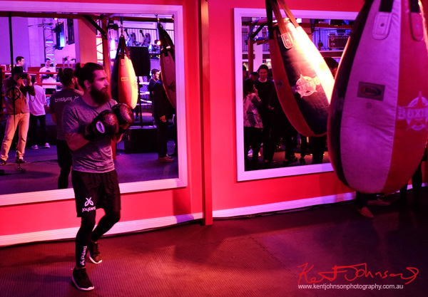A fitness model works the heavy bag, Boxing Works; at the Jaybird Freedom launch in Kings Cross Sydney. Photo by Kent Johnson for Street Fashion Sydney.