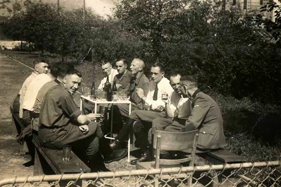 Finding comfort at Auschwitz: SS officers drink together.