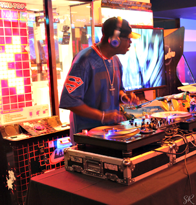 a DJ playing music at Bowlero grand opening